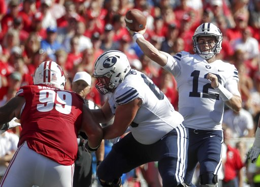 (AP Photo/Morry Gash). BYU quarterback Tanner Mangum throws during the first half of an NCAA college football game against Wisconsin Saturday, Sept. 15, 2018, in Madison, Wis.