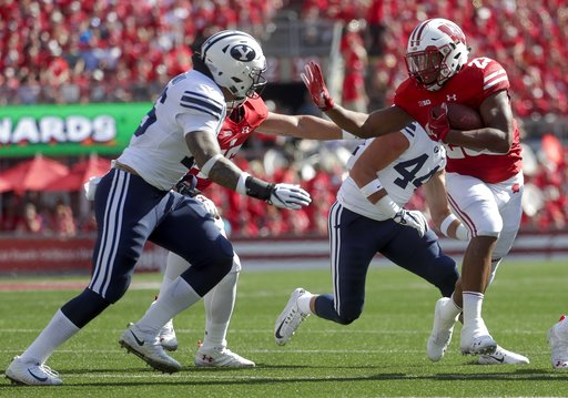 (AP Photo/Morry Gash). Wisconsin's Jonathan Taylor runs during the first half of an NCAA college football game against BYU Saturday, Sept. 15, 2018, in Madison, Wis.