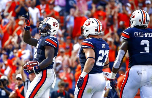 (AP Photo/Butch Dill). Auburn running back JaTarvious Whitlow (28) celebrates after scoring a touchdown during the first half of an NCAA college football game against LSU, Saturday, Sept. 15, 2018, in Auburn, Ala.