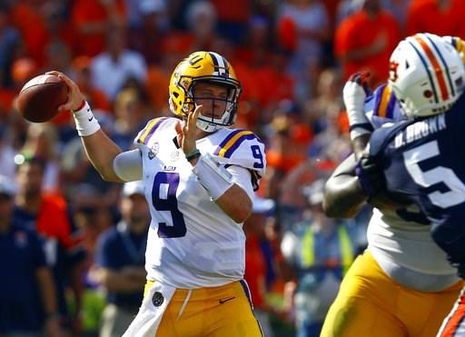 (AP Photo/Butch Dill). LSU quarterback Joe Burrow (9) throws a pass during the first half of an NCAA college football game against Auburn, Saturday, Sept. 15, 2018, in Auburn, Ala.