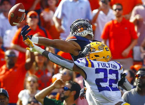 (AP Photo/Butch Dill). LSU cornerback Kristian Fulton (22) breaks up a pass in the end zone intended for Auburn wide receiver Darius Slayton (81) during the first half of an NCAA college football game, Saturday, Sept. 15, 2018, in Auburn, Ala.