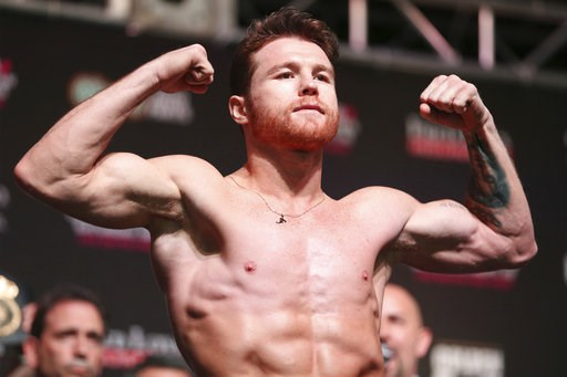(Erik Verduzco/Las Vegas Review-Journal via AP). Canelo Alvarez poses during a weigh-in at T-Mobile Arena in Las Vegas, Friday, Sept. 14, 2018. Alvarez will fight Gennady Golovkin on Saturday in a middleweight title bout.