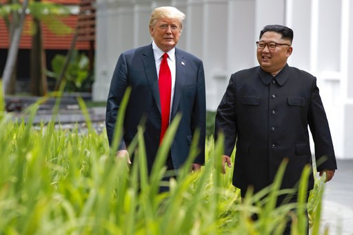 (AP Photo/Evan Vucci, File). FILE - In this June 12, 2018 file photo, President Donald Trump walks with North Korean leader Kim Jong Un on Sentosa Island, in Singapore. South Korea's liberal President Moon Jae-in faces growing skepticism at home about ...