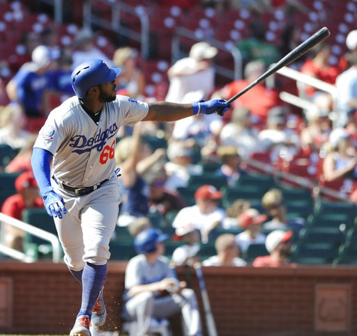 (AP Photo/Bill Boyce). Los Angeles Dodgers' Yasiel Puig (66) watches his third home run of the game a three-run homer against the St. Louis Cardinals in the eighth inning of a baseball game, Saturday, Sept. 15, 2018, at Busch Stadium in St. Louis.