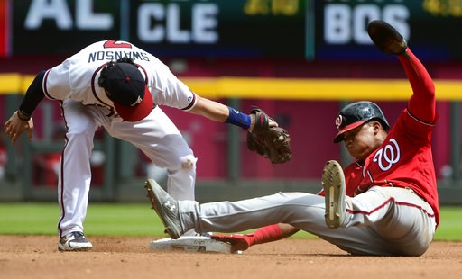 (AP Photo/John Amis). Washington Nationals' Juan Soto, right, steals second base as Atlanta Braves shortstop Dansby Swanson, left, tries to tag him during the fourth inning of a baseball game Saturday, Sept. 15, 2018, in Atlanta.