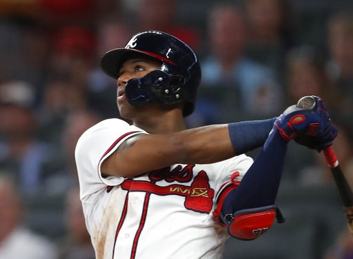 (AP Photo/John Bazemore). Atlanta Braves left fielder Ronald Acuna Jr. (13) hits triple in the fourth inning of a baseball game against the Washington Nationals Friday, Sept. 14, 2018, in Atlanta.