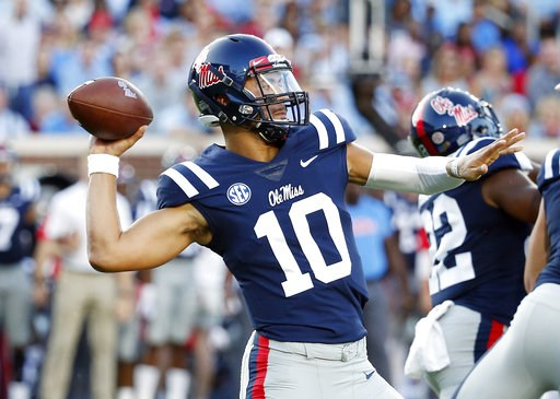 (AP Photo/Rogelio V. Solis). Mississippi quarterback Jordan Ta'amu (10) passes for a 79-yard touchdown against Alabama during the first half of their NCAA college football game, Saturday, Sept. 15, 2018, in Oxford, Miss.