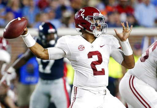(AP Photo/Rogelio V. Solis). Alabama quarterback Jalen Hurts (2) passes against Mississippi during the first half of their NCAA college football game on Saturday, Sept. 15, 2018, in Oxford, Miss.