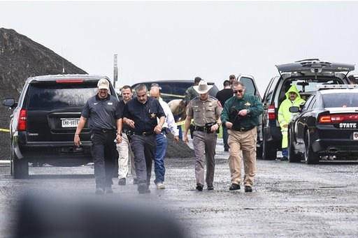 (Danny Zaragoza/The Laredo Morning Times via AP). Law enforcement officers gather near the scene where the body of a woman was found near Interstate 35 north of Laredo, Texas on Saturday, Sept. 15, 2018. A U.S. Border Patrol agent suspected of killing ...