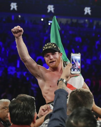 (AP Photo/Isaac Brekken). Canelo Alvarez celebrates after defeating Gennady Golovkin by majority decision in a middleweight title boxing match, Saturday, Sept. 15, 2018, in Las Vegas.
