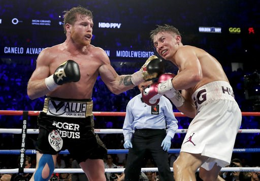 (AP Photo/Isaac Brekken). Canelo Alvarez lands a punch against Gennady Golovkin in the 12th round during a middleweight title boxing match, Saturday, Sept. 15, 2018, in Las Vegas. Alvarez won by majority decision.