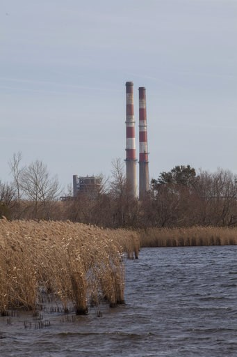 (AP Photo/Randall Hill, File). FILE - This Feb. 19, 2014 file photo shows the L.V. Sutton Complex operated by Duke Energy from the Sutton Lake landing in Wilmington, N.C. Duke Energy says heavy rains from Florence have caused a slope to collapse at a c...