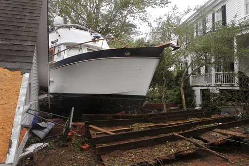 (Gray Whitley/Sun Journal via AP). A 40-foot yacht lies in the yard of a storm-damaged home on East Front Street in New Bern, N.C., Saturday, Sept. 15, 2018. The boat washed up with storm surge and debris from Hurricane Florence.
