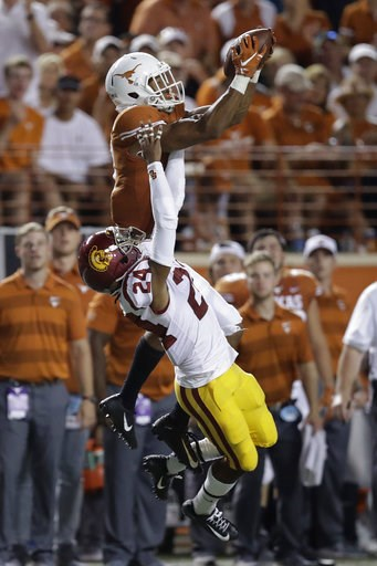(AP Photo/Eric Gay). Texas wide receiver Collin Johnson (9) makes a catch over Southern California cornerback Isaiah Langley (24) during the second half of an NCAA college football game, Saturday, Sept. 15, 2018, in Austin, Texas.