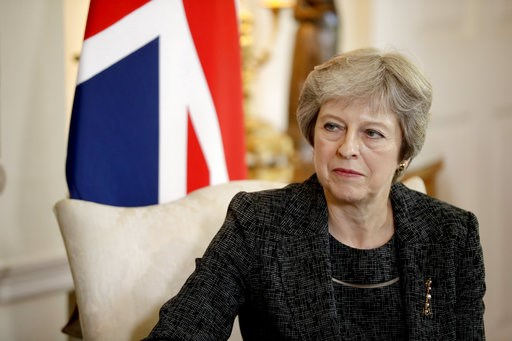 (Matt Dunham, Pool Photo via AP, File). FILE - In this July 24, 2018 file photo, British Prime Minister Theresa May listens at the start of her meeting with the Qatar's emir at 10 Downing Street in London. May has told the BBC in an interview scheduled...
