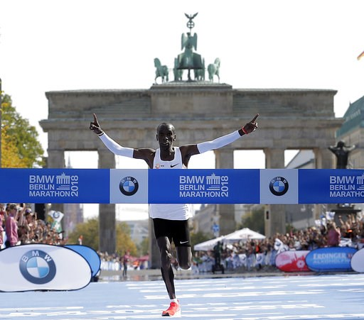 (AP Photo/Michael Sohn). Eliud Kipchoge runs to win the 45th Berlin Marathon in Berlin, Germany, Sunday, Sept. 16, 2018. Eliud Kipchoge set a new world record in 2 hours 1 minute 40 seconds.