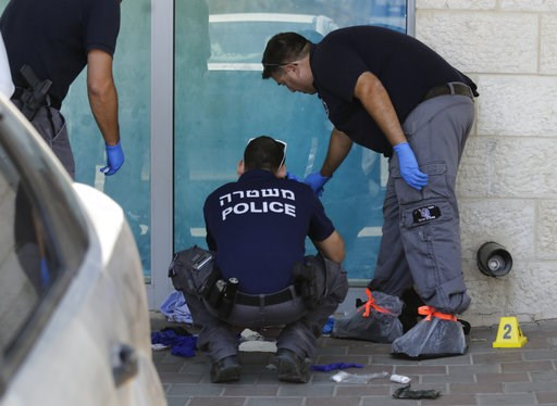 (AP Photo/Mahmoud Illean). Israeli police investigates at the scene of an stabbing attack in the West Bank settlement of Gush Etzion Sunday, Sept. 15, 2018. The Israeli military says a Palestinian attacker has stabbed and critically wounded an Israeli ...