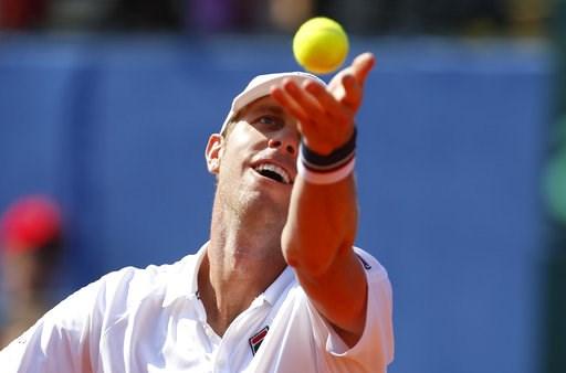 (AP Photo/Darko Bandic). Sam Querrey of the United States serves during the Davis Cup semifinal singles match against Marin Cilic of Croatia in Zadar, Croatia, Sunday, Sept. 16, 2018.