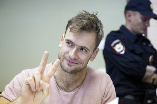 (AP Photo/Pavel Golovkin, File). FILE In this file photo taken on Monday, July 23, 2018, Pyotr Verzilov, a member of the feminist protest group Pussy Riot, gestures during hearings in a court in Moscow, Russia. Russian news reports say Verzilov a membe...