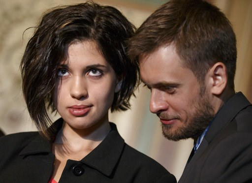 (AP Photo/J. Scott Applewhite). FILE - In this file photo taken on Tuesday, May 6, 2014, Russian political activist Nadya Tolokonnikova of the Russian punk band Pussy Riot, stands with her husband Pyotr Verzilov as they join Sen. Ben Cardin, D-Md., the...