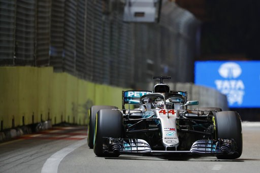 (AP Photo/Vincent Thian). Mercedes driver Lewis Hamilton of Britain steers his car during the Singapore Formula One Grand Prix at the Marina Bay City Circuit in Singapore, Sunday, Sept. 16, 2018.