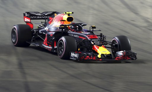 (AP Photo/Yong Teck Lim). Red Bull Racing driver Max Verstappen of Netherlands steers his car during the Formula One Grand Prix of Singapore at Marina Bay Street Circuit in Singapore, Sunday, Sept. 16, 2018.