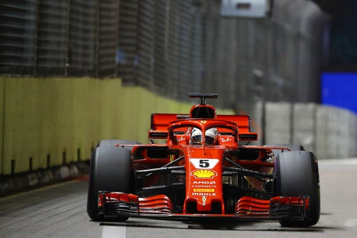 (AP Photo/Vincent Thian). Ferrari driver Sebastian Vettel of Germany steers his car during the Singapore Formula One Grand Prix at the Marina Bay City Circuit in Singapore, Sunday, Sept. 16, 2018.