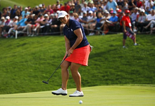 (AP Photo/Francois Mori). Angela Stanford of the U.S. puts on the 18th green during the fourth round of the Evian Championship women's golf tournament in Evian, eastern France, Sunday, Sept. 16, 2018.