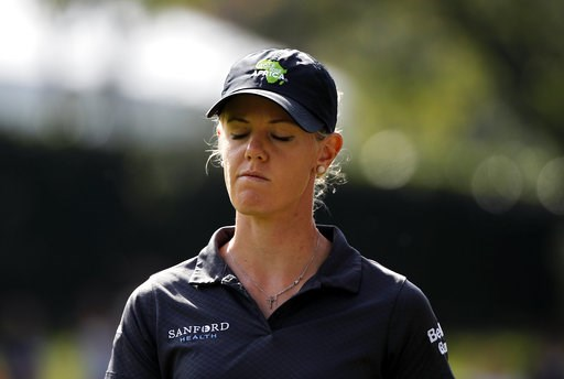 (AP Photo/Francois Mori). Amy Olson of the U.S. walks along the fairway during the fourth round of the Evian Championship women's golf tournament in Evian, eastern France, Sunday, Sept. 16, 2018.