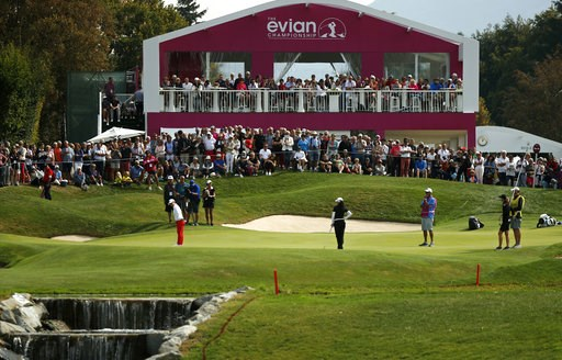 (AP Photo/Francois Mori). Sei Young Kim of Korea , Mo Martin of the U.S. and Amy Olson of the U.S., foreground from left to right, stand on the green of the 5th hole during the fourth round of the Evian Championship women's golf tournament in Evian, ea...