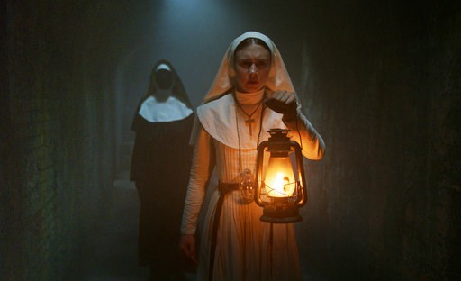 "(Warner Bros. Pictures via AP). This image released by Warner Bros. Pictures shows Taissa Farmiga in a scene from ""The Nun."""