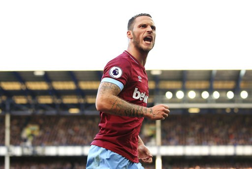(Peter Byrne/PA via AP). West Ham United's Marko Arnautovic celebrates scoring his side's third goal of the game , during the English Premier League soccer match between Everton and West Ham United, at Goodison Park, Liverpool, England, Sunday Sept. 16...