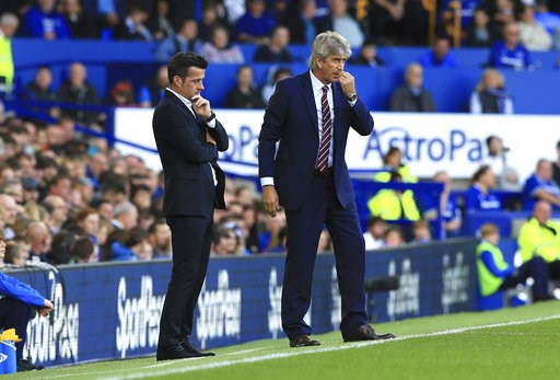 (Peter Byrne/PA via AP). Everton manager Marco Silva, left, and West Ham United manager Manuel Pellegrini look on from the sidelines during their English Premier League soccer match at Goodison Park in Liverpool, England, Sunday Sept. 16, 2018.