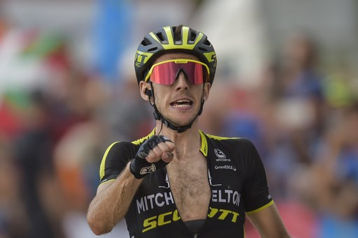 (AP Photo/Alvaro Barrientos, File). FILE - In this Saturday, Sept. 8, 2018 file photo, Mitchelton-Scott's Team Simon Yates of Britain celebrates after winning  the 14th stage between Cistierna and Les Praeres Nava, 171 kilometers (106,25 miles), of the...