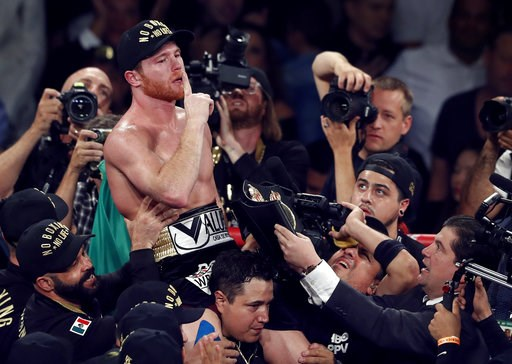 (Steve Marcus/Las Vegas Sun via AP). Canelo Alvarez, of Mexico, celebrates after defeating WBC/WBA middleweight champion Gennady Golovkin, of Khazakstan, in a title boxing fight at T-Mobile Arena in Las Vegas, Saturday, Sept. 15, 2018. Alvarez took Glo...