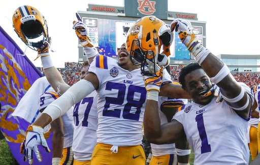 (AP Photo/Butch Dill). LSU players celebrate after they defeated Auburn on a last second field goal during the second half of an NCAA college football game, Saturday, Sept. 15, 2018, in Auburn, Ala. LSU won 22-21.