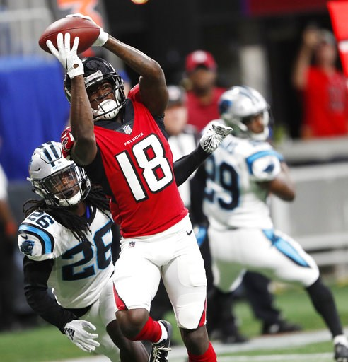 (AP Photo/John Bazemore). Atlanta Falcons wide receiver Calvin Ridley (18) makes a touchdown catch against Carolina Panthers cornerback Donte Jackson (26) during the first half of an NFL football game, Sunday, Sept. 16, 2018, in Atlanta.