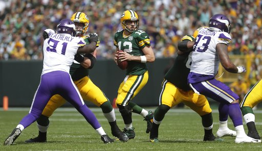 (AP Photo/Morry Gash). Green Bay Packers' Aaron Rodgers drops back during the first half of an NFL football game against the Minnesota Vikings Sunday, Sept. 16, 2018, in Green Bay, Wis.