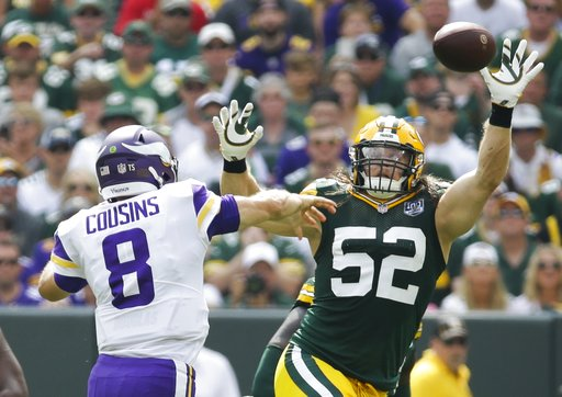 (AP Photo/Mike Roemer). Minnesota Vikings' Kirk Cousins throws over Green Bay Packers' Clay Matthews during the first half of an NFL football game Sunday, Sept. 16, 2018, in Green Bay, Wis.
