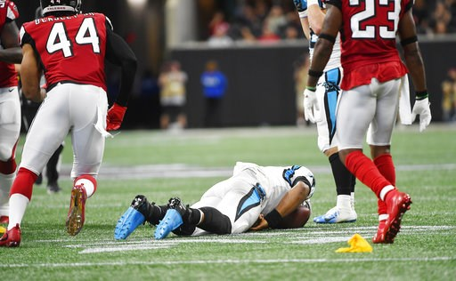 (AP Photo/John Amis). Carolina Panthers quarterback Cam Newton (1) lies on the turf after being hit by Atlanta Falcons cornerback Damontae Kazee (27) during the first half of an NFL football game, Sunday, Sept. 16, 2018, in Atlanta. Kazee was ejected f...
