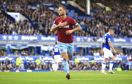 (Peter Byrne/PA via AP). West Ham United's Marko Arnautovic celebrates scoring his side's third goal of the game,  during the English Premier League soccer match between Everton and West Ham United, at Goodison Park, Liverpool, England, Sunday Sept. 16...