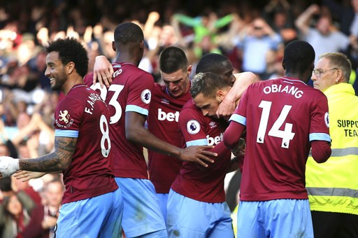 (Peter Byrne/PA via AP). West Ham United's Marko Arnautovic, centre, celebrates scoring his side's third goal of the game with teammates, during the English Premier League soccer match between Everton and West Ham United, at Goodison Park, Liverpool, E...