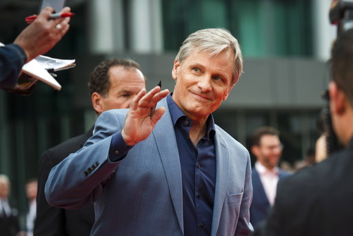 "(Christopher Katsarov/The Canadian Press via AP). Actor Viggo Mortensen waves to fans as he arrives ahead of the screening of ""Green Book"" during the Toronto International Film Festival in Toronto, on Tuesday, Sept. 11, 2018."