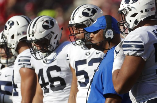 (AP Photo/Morry Gash). BYU head coach Kalani Sitake watches during the second half of an NCAA college football game against Wisconsin Saturday, Sept. 15, 2018, in Madison, Wis. BYU won 24-21.