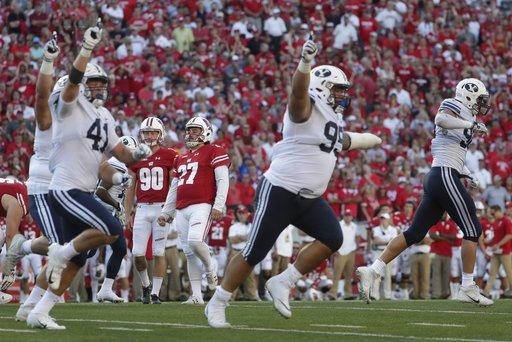 (AP Photo/Morry Gash). BYU players react after Wisconsin kicker Rafael Gaglianone missed a field goal in the final seconds of the second half of an NCAA college football game Saturday, Sept. 15, 2018, in Madison, Wis. BYU won 24-21.