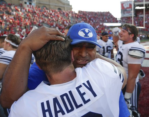 (AP Photo/Morry Gash). BYU head coach Kalani Sitake celebrates with Matt Hadley after an NCAA college football game against Wisconsin Saturday, Sept. 15, 2018, in Madison, Wis. BYU won 24-21.