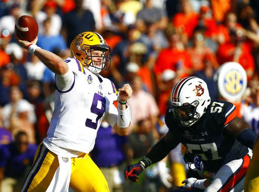 (AP Photo/Butch Dill). LSU quarterback Joe Burrow (9) throws a pass during the second half of an NCAA college football game against Auburn, Saturday, Sept. 15, 2018, in Auburn, Ala.