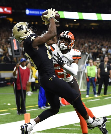(AP Photo/Bill Feig). New Orleans Saints wide receiver Michael Thomas, left, scores a touchdown over Cleveland Browns cornerback Denzel Ward during the second half of an NFL football game in New Orleans, Sunday, Sept. 16, 2018.