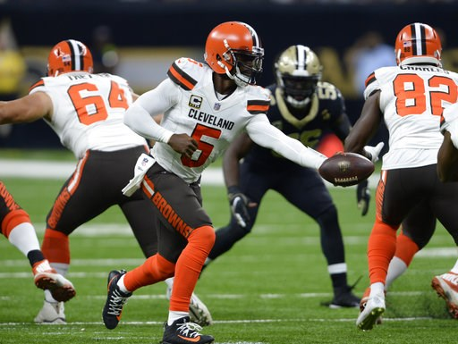 (AP Photo/Bill Feig). Cleveland Browns quarterback Tyrod Taylor (5) hands off the football during the first half of an NFL football game against the New Orleans Saints in New Orleans, Sunday, Sept. 16, 2018.