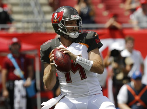 (AP Photo/Chris O'Meara). Tampa Bay Buccaneers quarterback Ryan Fitzpatrick (14) looks to pass,during the first half of an NFL football against the Philadelphia Eagles, Sunday, Sept. 16, 2018, in Tampa, Fla.